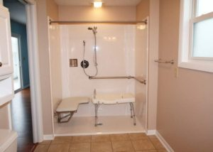A picture of a handicap bathroom design by Tamer Construction to include a large, handicap-accessible shower stall.